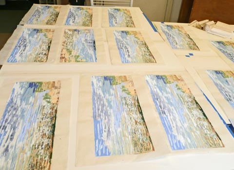 Woodcut prints, laid out to dry
