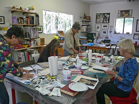 Altered books workshop, photo of participants hard at work